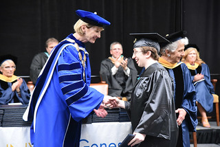 Sun, 05/20/2018 - 14:05 - Lauren Stumpf shaking hands with SUNY Chancellor Johnson at GCC's 50th Commencement Ceremony on May 20, 2018
