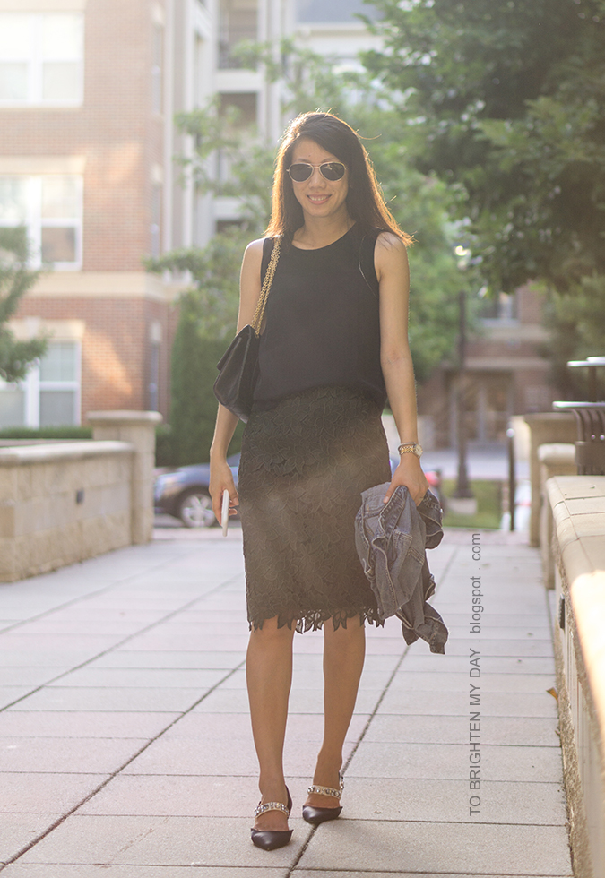 black sleeveless silk top, black shoulder bag, olive green lace pencil skirt, denim jacket, two tone watch, silver cuff, black ballerina flats with jeweled straps