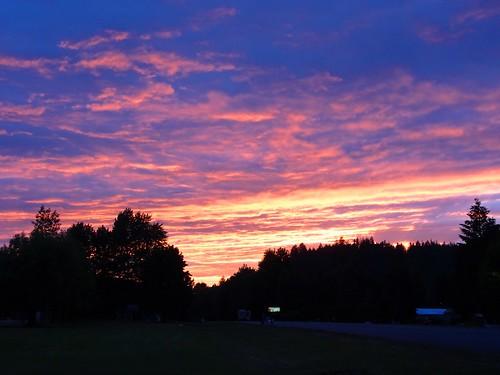 sunset sun clouds colors trees landscape grass