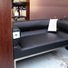 Black leatherette 2 seater sofa E225