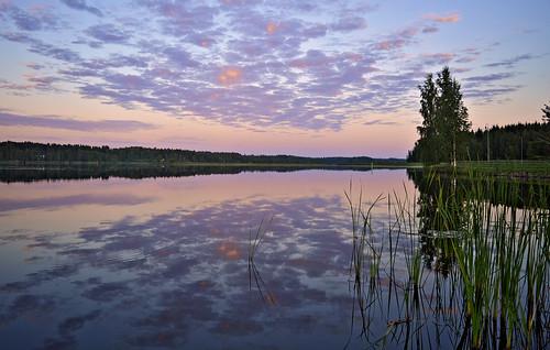 Opposite side of sunset over lake Päijänne. Sysmä. Finland. Summer 2018.