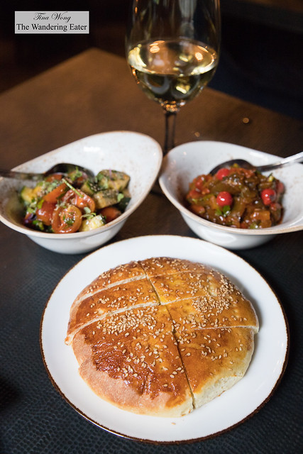 Khiar Maticha (fresh tomato and Persian cucmber salad), Tatouka (stewed fire roasted peppers, tomato concasse, piquillo stew served cold) and fresh baked bread