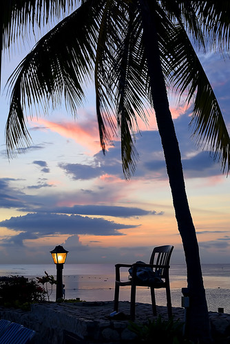 night sunset sky lamp palmtree chair towel loungechairs clouds pretty lovely gorgeous beautiful mobay montegobay jamaica westindies caribbean ja silhouette bouys water ocean caribbeansea ripples reflections calm serene tranquil peaceful romantic