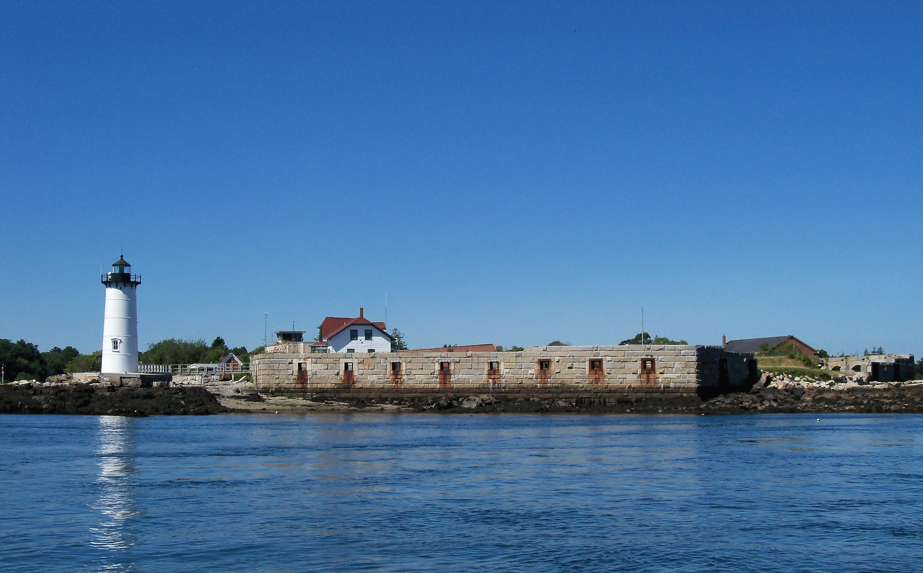 Fort Constitution on the Piscataqua River between New Hampshire and Maine. To the left is Portsmouth Harbor Light, completed in 1878. Its Fourth Order Fresnel lens remains a valuable aid to navigation. Photo taken on August 15, 2013.