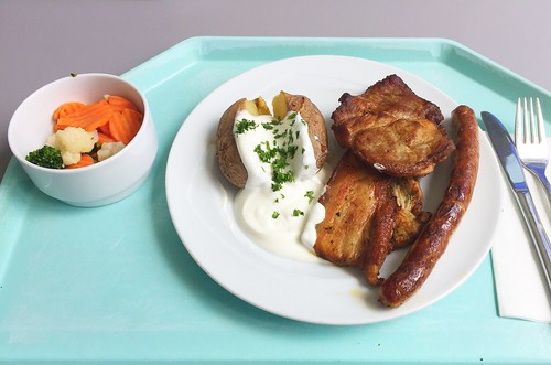 BBQ dish with marinated pork & turkey steak, fried sausage & pork belly, oven potato & curd dip / Grillteller mit mariniertem Schweine und Putensteak, Grillwürstchen und Wammerl, Ofenkartoffel & Quarkdip