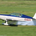 G-BZII - 1999 build Extra EA.300L, rolling for departure on Runway 26L at Barton