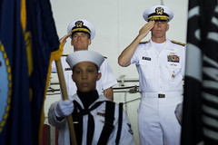 PHILIPPINE SEA (July 18, 2018) Rear Adm. Marc Dalton, left, and Rear Adm. Karl O. Thomas salute the colors during the Commander, Task Force (CTF) 70 change of command ceremony in the hangar bay aboard the aircraft carrier USS Ronald Reagan (CVN 76). Thomas relieved Dalton as commander, CTF 70. CTF 70 is forward-deployed to the U.S. 7th Fleet area of operations in support of security and stability in the Indo-Pacific region. (U.S. Navy photo by Mass Communication Specialist Codie L. Soule/Released)