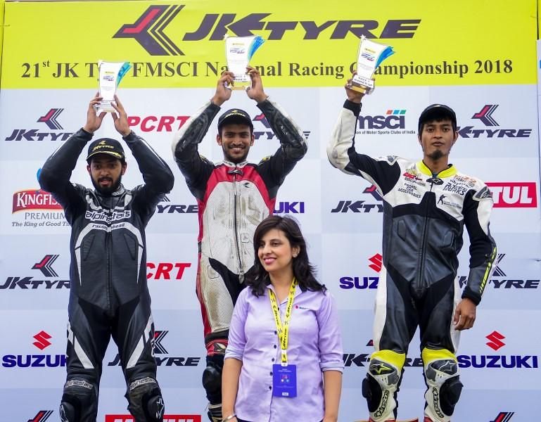 Suzuki Gixxer Cup_Round 1_(L to R) - Malsawmdawngliana, Joseph Matthew and Syed Muzamil Ali with Deepali Mishra, Head of Marketing, SMIPL  (Copy)