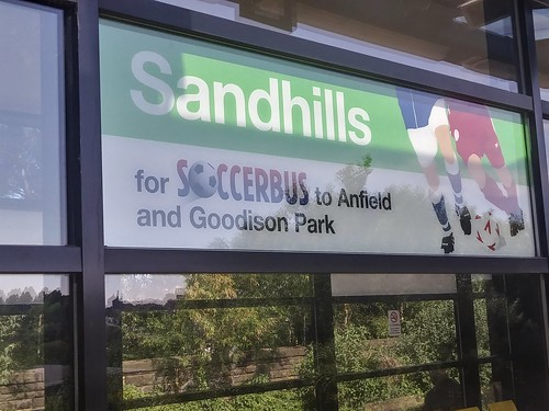 Sign promoting the Soccerbus service at the Merseyrail Sandhills station