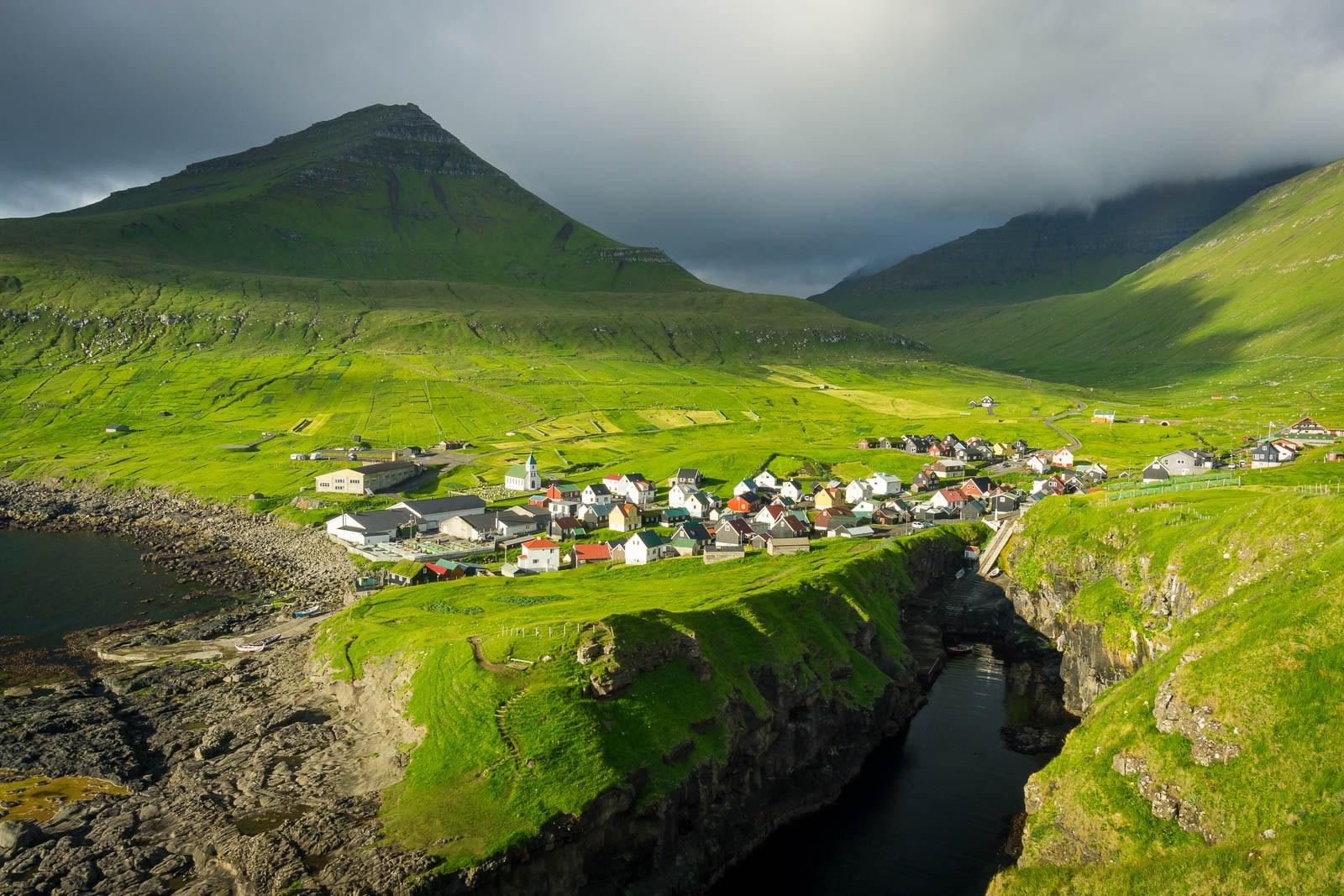 The village of Gjógv on Eysturoy in the Faroe Islands, bathed in morning light. Photo taken on July 26, 2016.