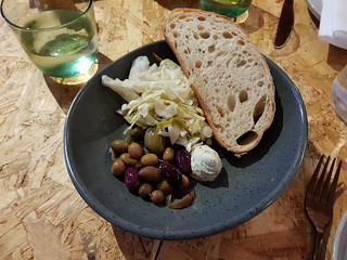 Olives, sauerkraut, sesame cheese at Grown