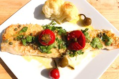 BAKED ATLANTIC COD FILLET, CAULIFLOWER, SWEET CHERRY PEPPERS AND CAPERS IN LEMON & EVO