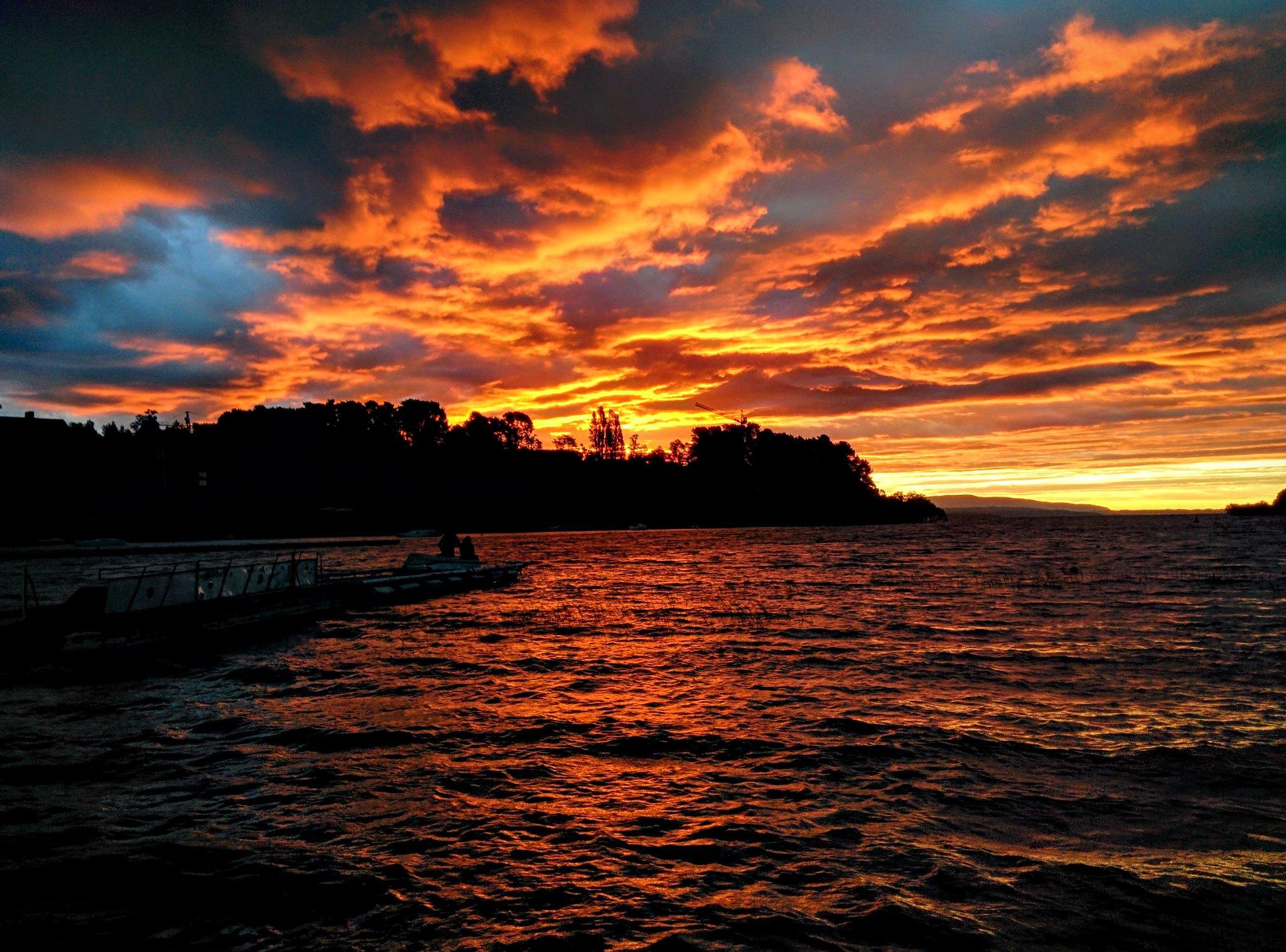 Vivid orange sunset over lake Lago Villarrica (from previous night)