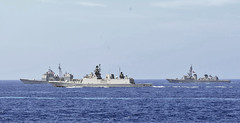 PHILIPPINE SEA (June 15, 2018) The guided-missile cruiser USS Chancelorsville (CG 62), Indian Navy stealth multi-role frigate INS Sahyadri (F 49) and Japan Maritime Self-Defense Force destroyer JS Suzunami (DD 114) sail in formation during Malabar 2018. Malabar 2018 is the 22nd rendition of the exercise and the first time it has been hosted off the coast of Guam. Malabar is designed to advance military-to-military coordination in a multinational environment between the U.S., Japan and Indian maritime forces. (U.S. Navy photo by Mass Communication Specialist 2nd Class William McCann/Released)