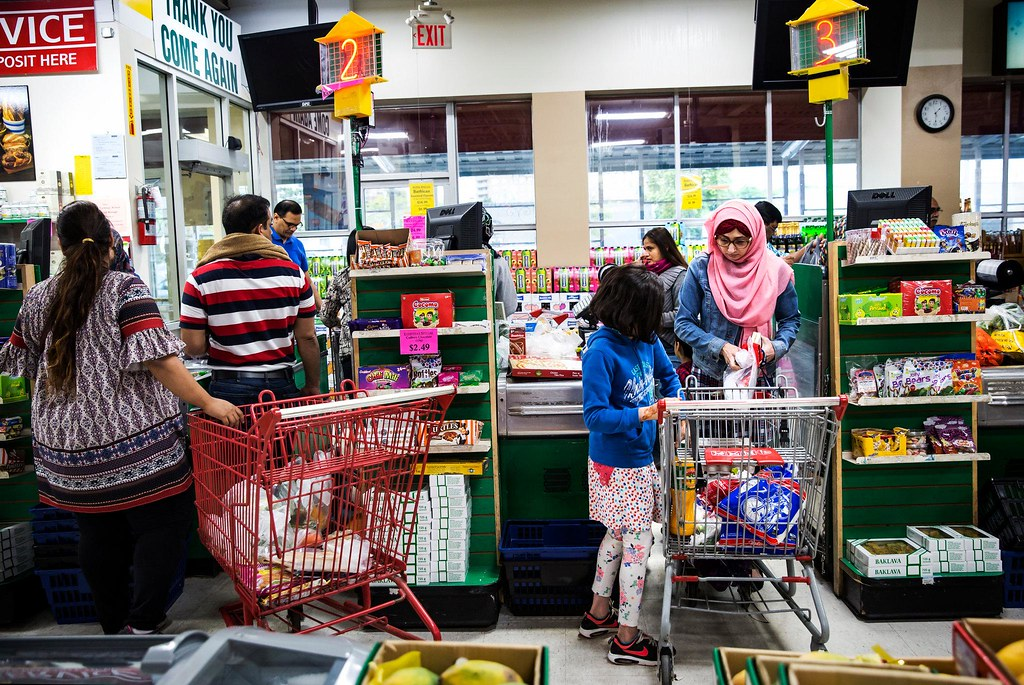 Customers at Iqbal Halal Foods, a grocery store in Toronto's Thorncliffe Park neighborhood.
