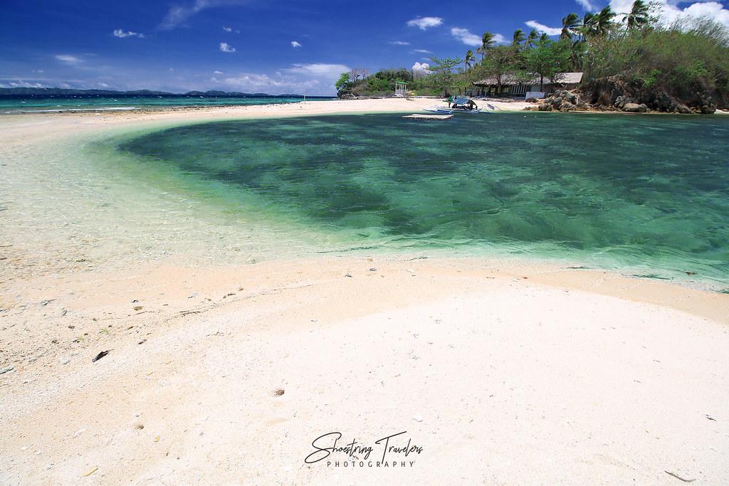 Aslom Island's curving white sandbar