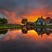 Fire around the wooden house by fischerfotografie.nl