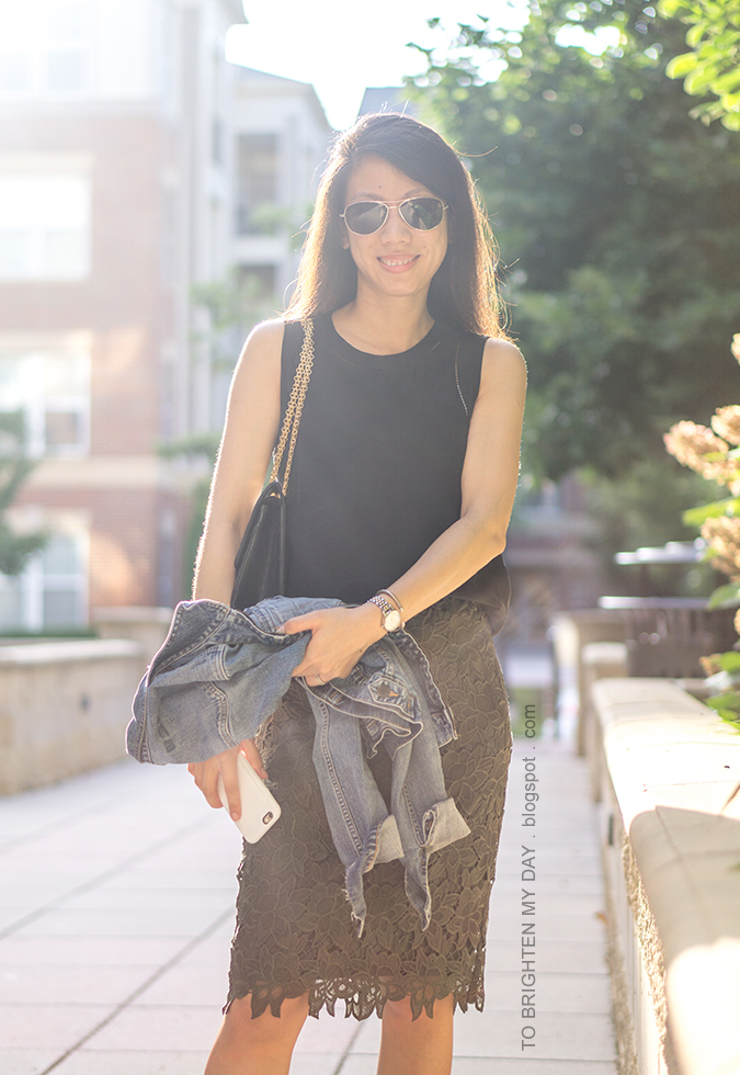 black sleeveless silk top, black shoulder bag, olive green lace pencil skirt, denim jacket, two tone watch, silver cuff