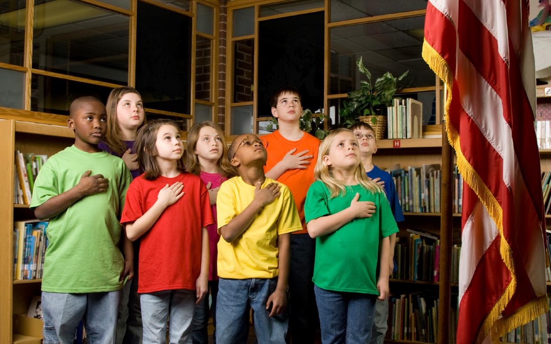 Pledging allegiance to the U.S. flag.