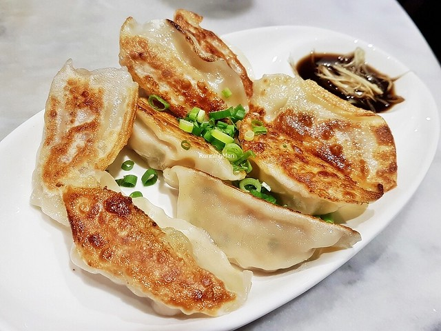 Pan-Fried Dumplings Stuffed With Minced Pork And Chinese Cabbage