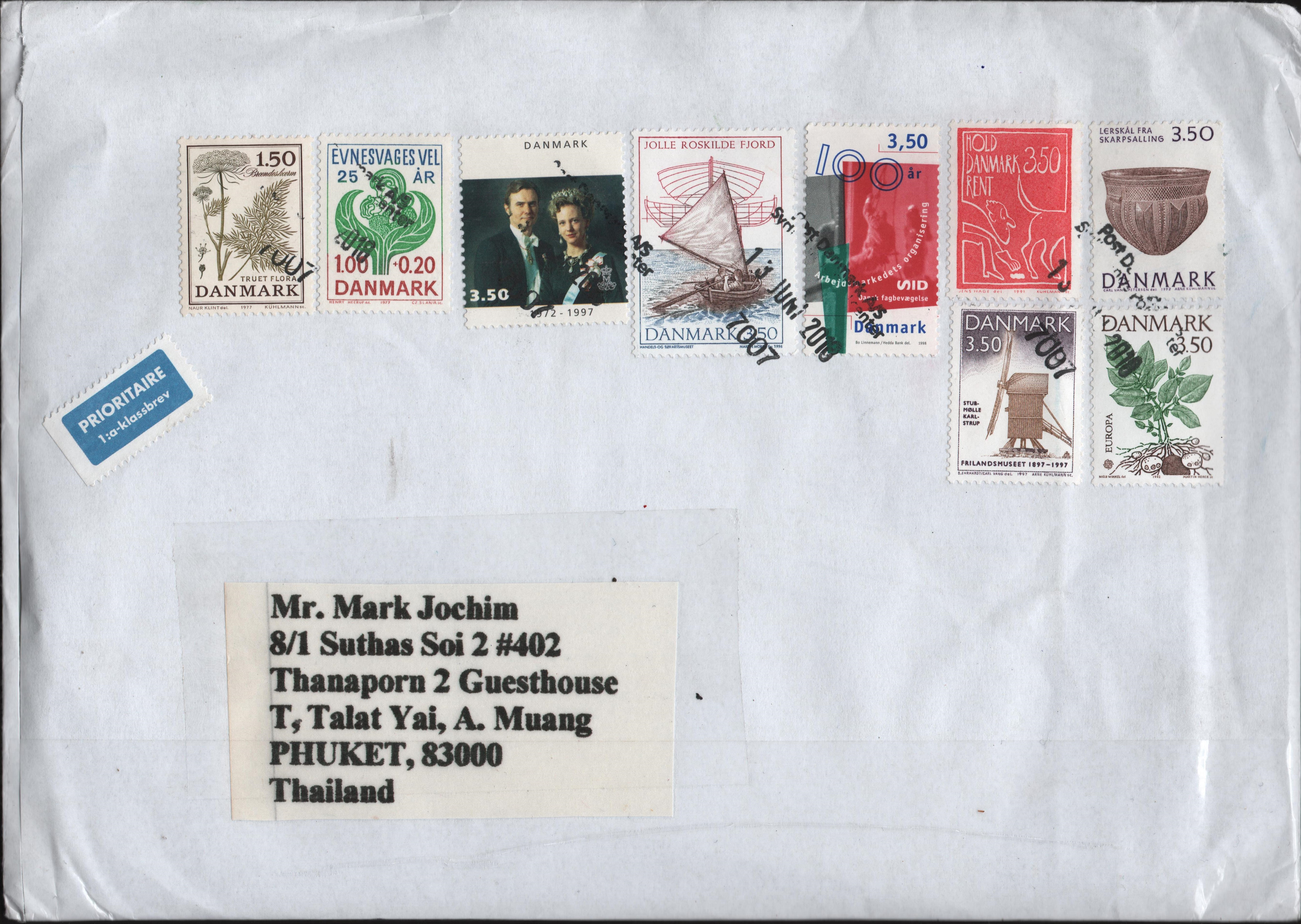 Packet mailed from Denmark to Thailand in June 2018 bearing nine Danish stamps including Scott #1067.