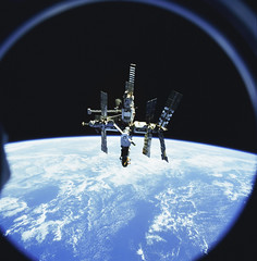 Russia's Mir space station is backdropped against Earth's horizon. Original from NASA. Digitally enhanced by rawpixel.