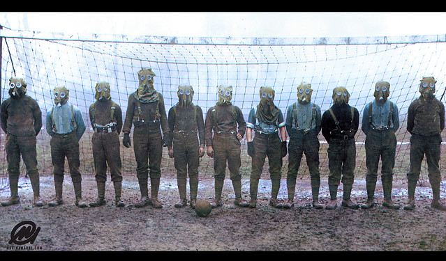 Soccer team of British WWI soldiers wearing gas masks, France, 1916.