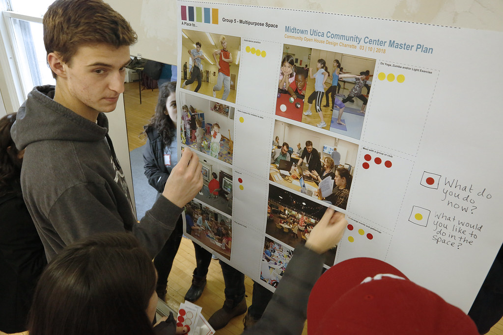 Visitors participate with visually interactive posters during the community open house.