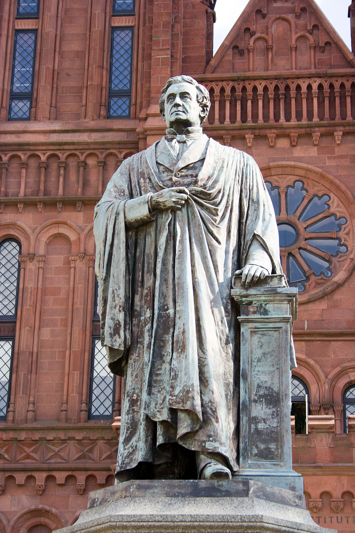 Statue of Joseph Henry, a Scottish-American physicist who served as the first Secretary of the Smithsonian Institution, in front of the Smithsonian Institution Building (Smithsonian Castle) in Washington, D.C. Photo taken by David Bjorgen on May 17, 2005