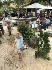 The twins marvel at all the sand on the ground at this restaurant