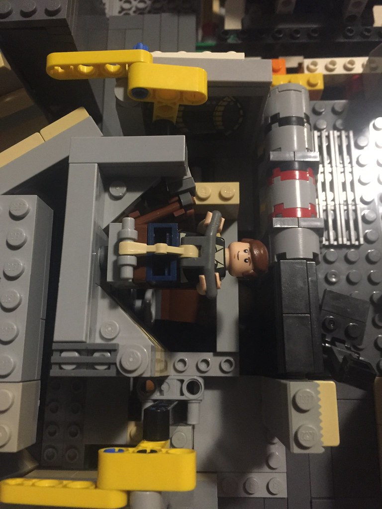 Modifying the Millennium Falcon heavily, with removable shooter cockpit with the flooring behind on top of a double lattice which is connected to the rest of ships skeleton.