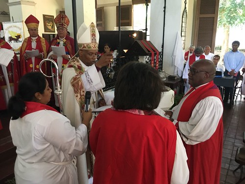 Archbishop Julio Murray receives a plumb line as a symbol of prophecy