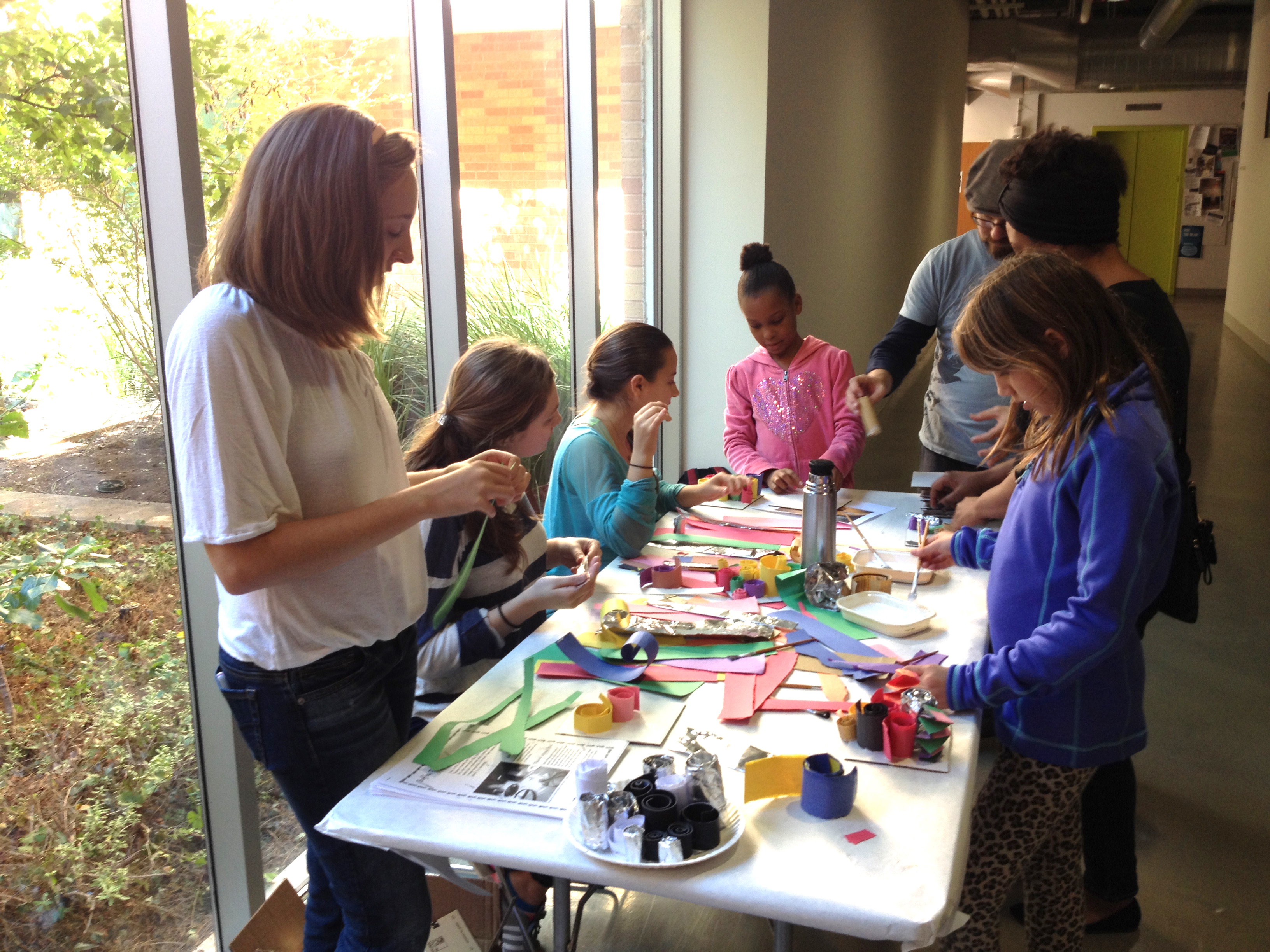 kids around table making art