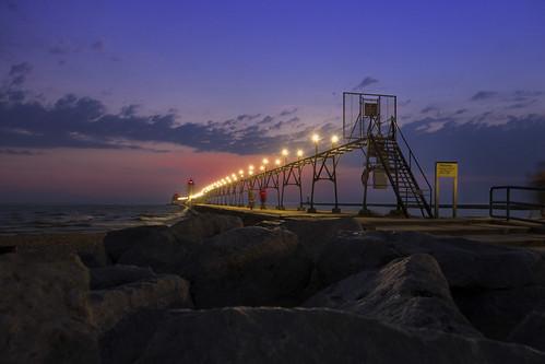 Grand Haven lighthouse sunset. Photographer Gregory Bozik