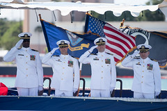 The official party salutes during the USS Columbia (SSN 771) change of command ceremony, Aug. 3. (U.S. Navy/MC1 Daniel Hinton)
