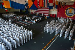 The crew of USS John C. Stennis stands in ranks during the aircraft carrier's change of command ceremony, Aug. 3. (U.S. Navy/MC3 William Rosencrans)