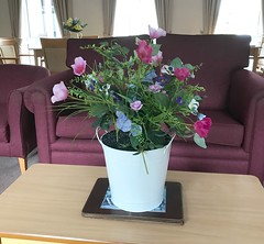 Flowers in our communal Lounge .