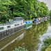 Static narrowboats on the Rochdale Canal at Hebden Bridge.