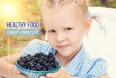 Pretty girl with blackberry. Healthy nutrition.