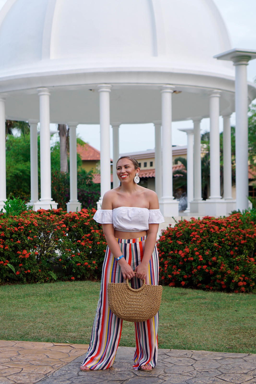 White Off Shoulder Crop Top Rainbow Striped Wide Leg Pants Tropical Vacation Outfit Punta Cana Holiday Summer