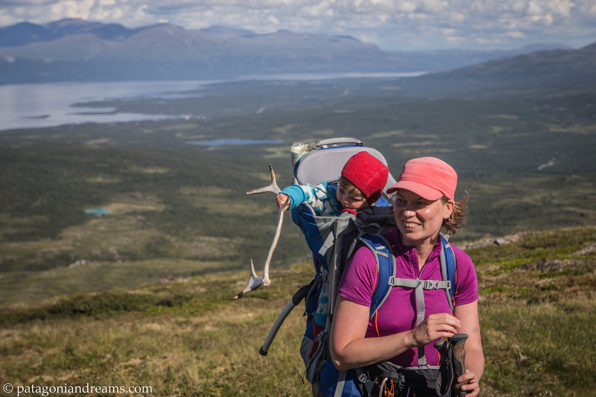 Investigating a reindeer antler on an exploration high above the Torneträsk lake. Abisko. Swedish Lapland.