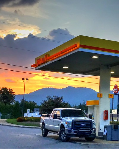 sunset urban truck gasstation cantonnc northcarolina sky clouds