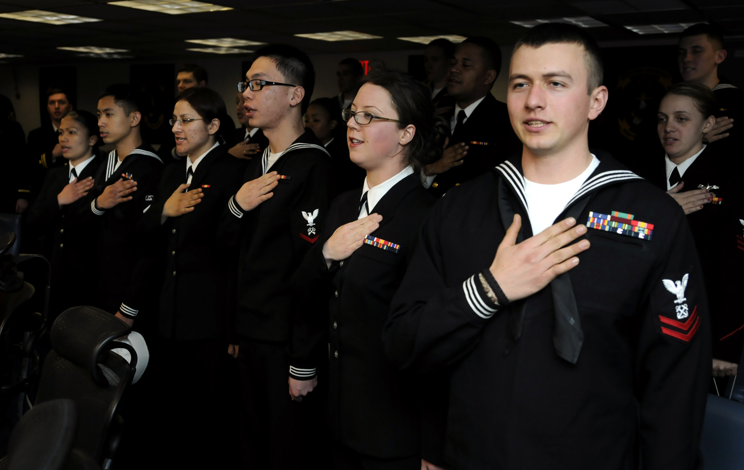 Sailors recite the pledge of allegiance as they become U.S. citizens during a naturalization ceremony aboard the U.S. 7th Fleet command ship USS Blue Ridge (LCC 19) at Busan, South Korea. U.S. Navy photo by Mass Communication Specialist 3rd Class Daniel Viramontes taken on March 8, 2010.
