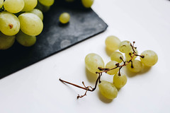 Close up of grapes on white background