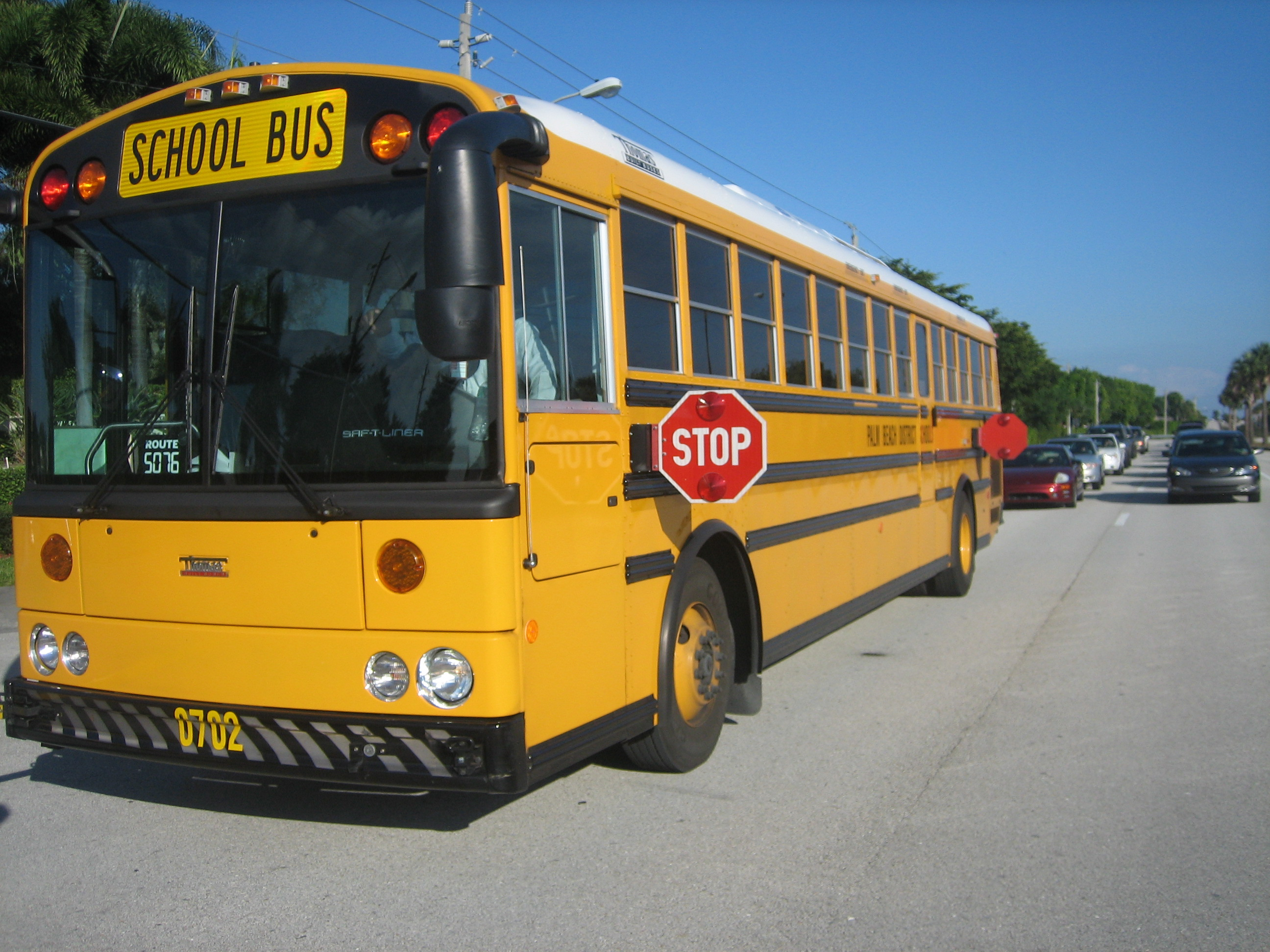 A Thomas Saf-T-Liner HDX school bus in the United States, displaying front and rear folding stop signs. Photo taken on December 21, 2007.