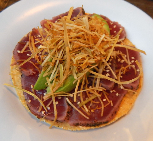 Tuna tostados, a fusion dish with lightly seared tuna piled on the traditional tostado