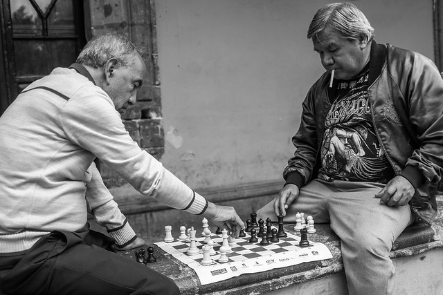 Mexican men playing chess