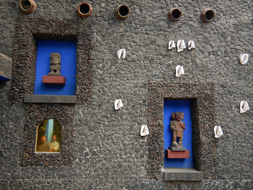 Pre-hispanic art and shells decorate the lava stone walls of the artist Frida Kahlo's 'Casa Azul', the cobalt blue house in Coyoacán, Mexico