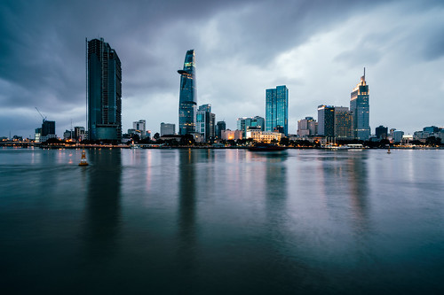 Beautiful view of Ho Chi Minh City skyline and skyscrapers in center of heart business at Ho Chi Minh City downtown. Panorama of cityscape on Saigon river in Ho Chi Minh City at Vietnam at sunset scene