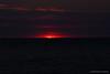 Le soleil disparaît derrière l'horizon